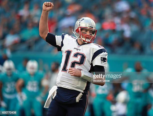 New England Patriots quarterback Tom Brady pumps his fist after teammate LeGarrette Blount scored a fourth quarter touchdown that helped seal New...