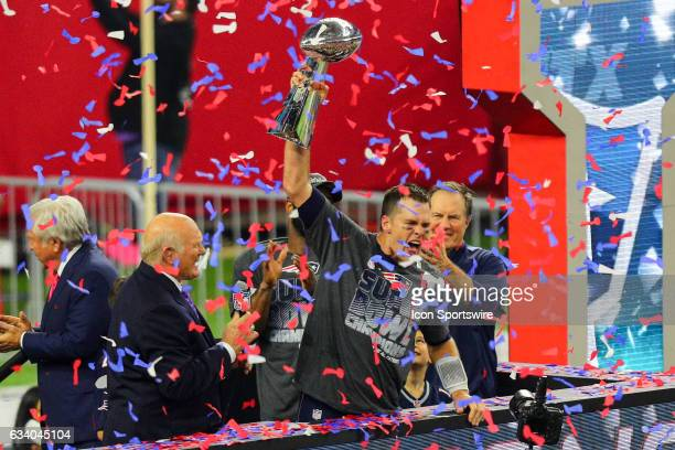 New England Patriots Quarterback Tom Brady raises the Vince Lombardi Trophy to celebrate the victory during the New England Patriots 3428 victory...