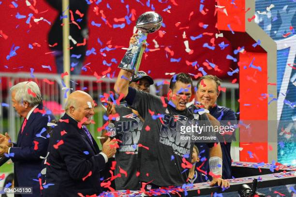 New England Patriots Quarterback Tom Brady raises the Vince Lombardi Trophy to celebrate the victory during the New England Patriots 3428 victory...