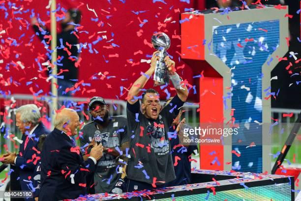 New England Patriots Quarterback Tom Brady raises the Vince Lombardi Trophy to celebrate the victory during the New England Patriots 34-28 victory...