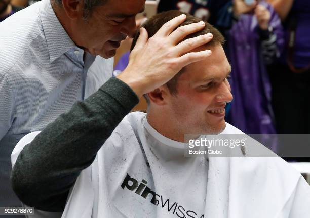 New England Patriots quarterback Tom Brady reacts as he gets his head shaved as part of Saving By Shaving 5 benefiting the DanaFarber Cancer...