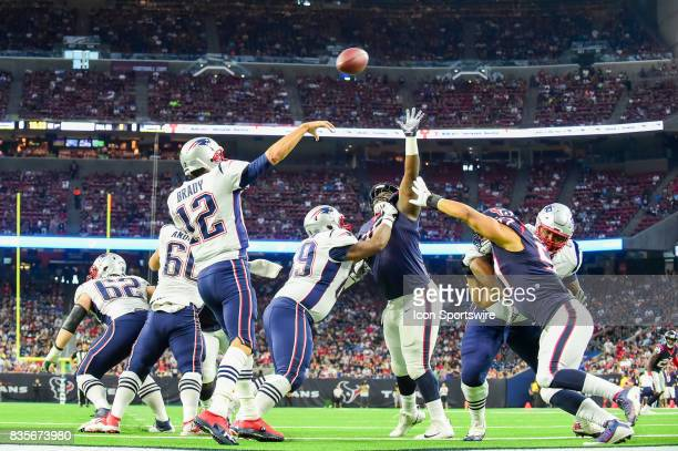 New England Patriots quarterback Tom Brady releases the ball under pressure during the NFL preseason game between the New England Patriots and the...