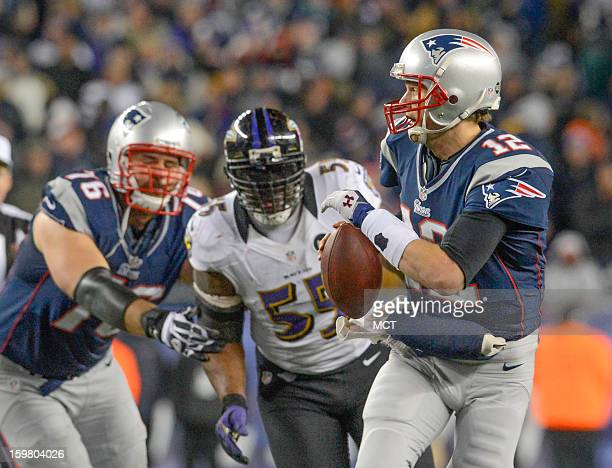 New England Patriots quarterback Tom Brady runs from the pocket to escape the oncoming pressure of Baltimore Ravens outside linebacker Terrell Suggs...
