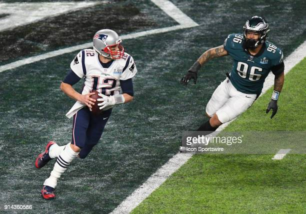 New England Patriots Quarterback Tom Brady scrambles as Philadelphia Eagles Defensive End Derek Barnett pursues during Super Bowl LII on February 04,...