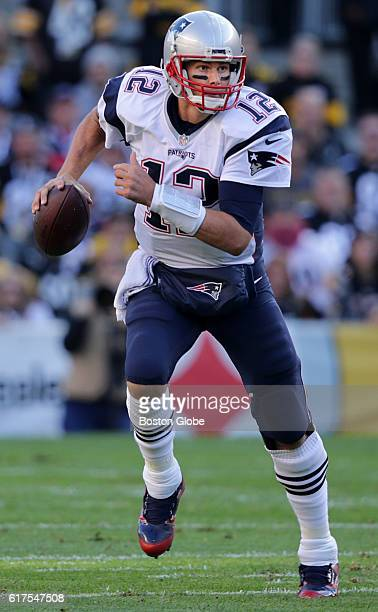 New England Patriots quarterback Tom Brady scrambles with the ball during the first quarter The Pittsburgh Steelers host the New England Patriots at...