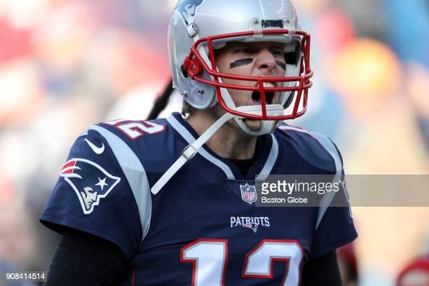 New England Patriots quarterback Tom Brady screams let's go after running onto the field before the game The New England Patriots host the...