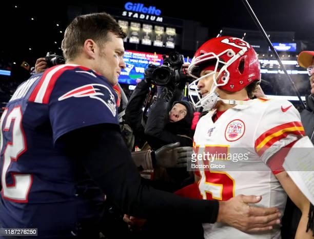New England Patriots quarterback Tom Brady shakes hands with Kansas City Chiefs quarterback Patrick Mahomes after the Chief defeated the Patriots...