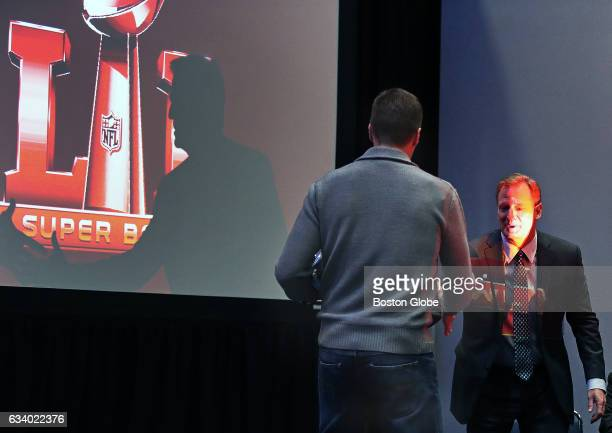 New England Patriots quarterback Tom Brady shakes NFL commissioner Roger Goodell after Goodell presented Brady with the Super Bowl MVP trophy in...