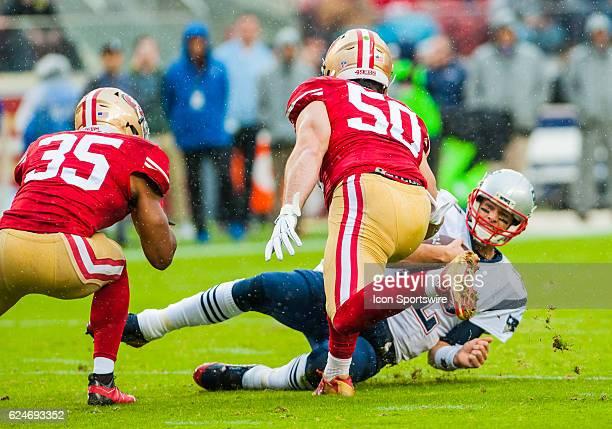 New England Patriots quarterback Tom Brady slides onto the turf during the regular season NFL game verses the San Francisco 49ers and the New England...