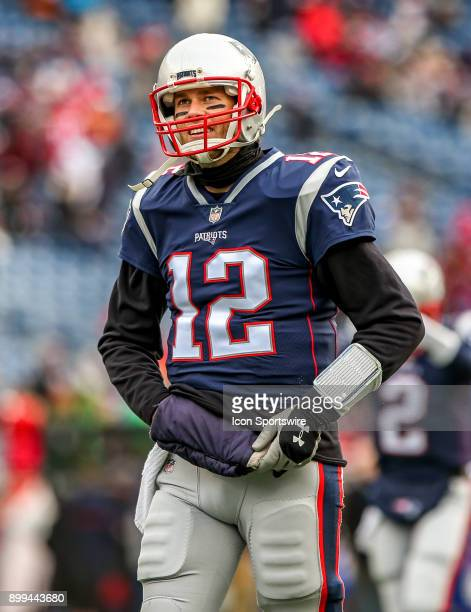 New England Patriots quarterback Tom Brady smiles during warm up drills prior to the start of a National Football League game between the between the...