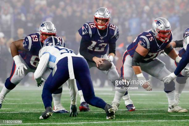 New England Patriots quarterback Tom Brady takes the snap during an AFC Wild Card game between the New England Patriots and the Tennessee Titans on...