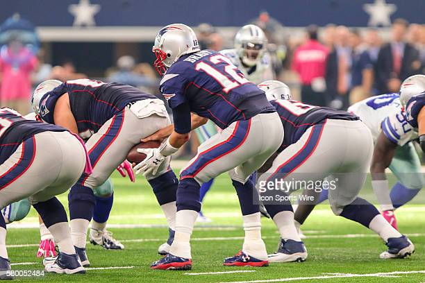 New England Patriots quarterback Tom Brady takes the snap from center during the game between the Dallas Cowboys and the New England Patriots at ATT...