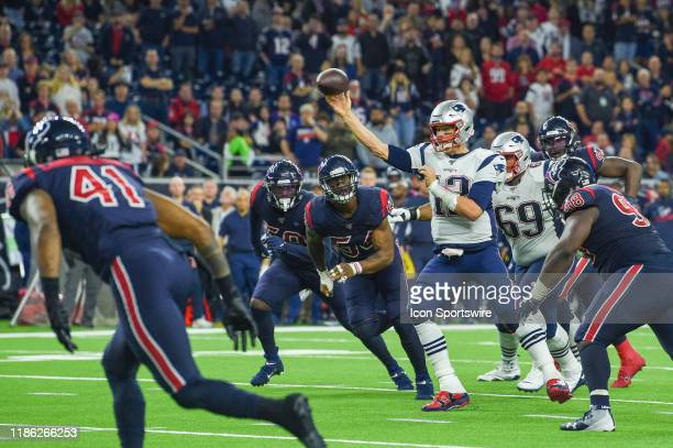 New England Patriots quarterback Tom Brady throws a touchdown strike under heavy pressure during the football game between the New England Patriots...