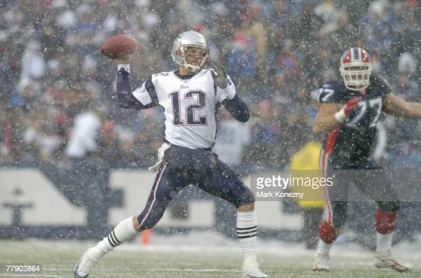 New England Patriots quarterback Tom Brady throws in the snow during a game against the Buffalo Bills at Ralph Wilson Stadium in Orchard Park, New...