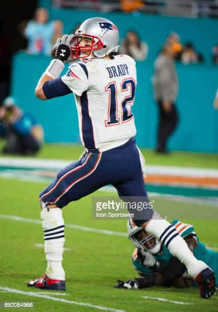 New England Patriots Quarterback Tom Brady throws the ball as Miami Dolphins Defensive End Charles Harris fails to sack Brady during the NFL football...