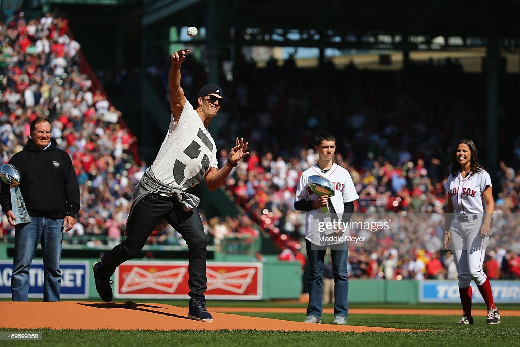 New England Patriots quarterback Tom Brady throws the first pitch before the game between the Washington Nationals and the Boston Red Sox at Fenway Park on April 13, 2015 in Boston, Massachusetts.