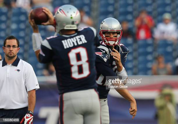 New England Patriots quarterback Tom Brady throws to New England Patriots quarterback Brian Hoyer during pre game warmup before a preseason...