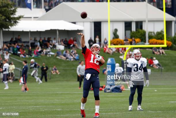 New England Patriots quarterback Tom Brady tosses a bomb during New England Patriots training camp on July 29 at the Patriots Practice Facility in...