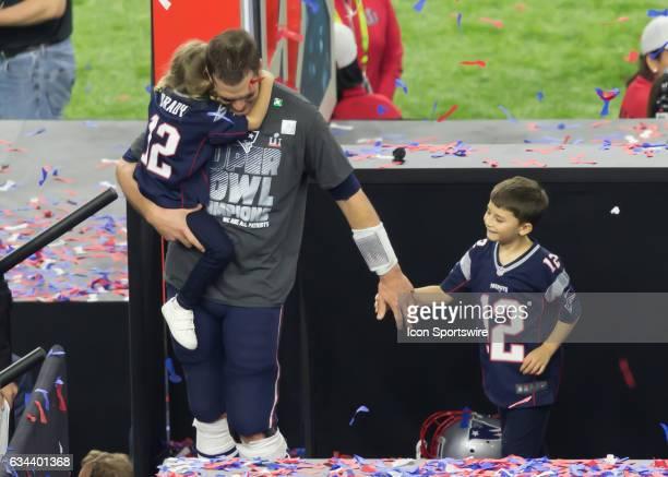 New England Patriots quarterback Tom Brady walks his children off the victors' podium during the Super Bowl LI between the New England Patriots and...