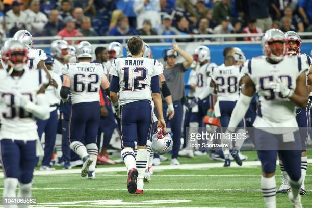 New England Patriots quarterback Tom Brady walks to the sideline at the change of possession during a regular season game between the New England...