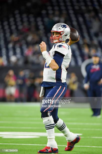 New England Patriots quarterback Tom Brady warms up before the football game between the New England Patriots and Houston Texans at NRG Stadium on...
