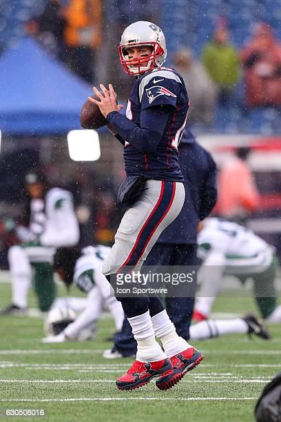 New England Patriots quarterback Tom Brady warms up prior to the National Football League game between the New England Patriots and the New York Jets...
