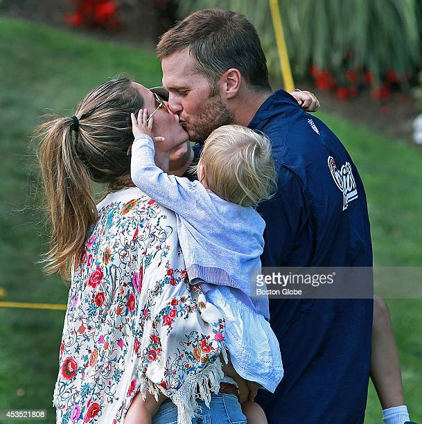 New England Patriots quarterback Tom Brady was met after practice on August 11 2014 by his wife Gisele Bundchen and their son and daughter The...
