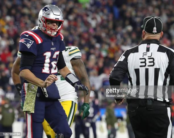 New England Patriots quarterback Tom Brady yells at field judge Steve Zimmer during the third quarter The New England Patriots host the Green Bay...
