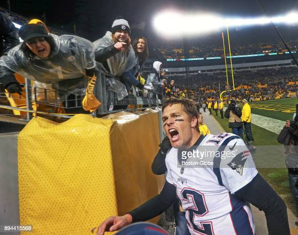 New England Patriots quarterback Tom Brady yells his trademark Let's Go to fans as Pittsburgh Steelers fans scream at him while he leaves the field...