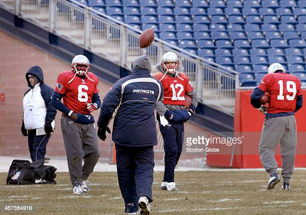 New England Patriots quarterbacks Rohan Davey Tom Brady and Damon Huard work out inside Gillette Stadium on the newly installed turf
