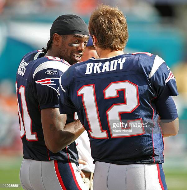 New England Patriots Randy Moss and Tom Brady talk on the sideline in the fourth quarter of their game against the Miami Dolphins The Patriots...