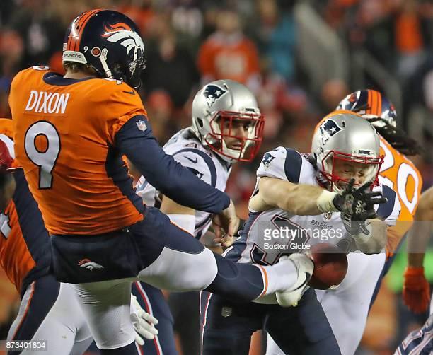 New England Patriots Rex Burkhead blocks Denver Broncos Riley Dixon's punt during second quarter action at Sports Authority Field at Mile High...
