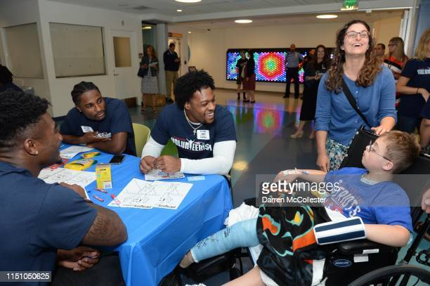 New England Patriots rookie JoeJuan Williams and N'Keal Harry visit with Nate at Boston Children's Hospital June 20 2019 in Boston Massachusetts