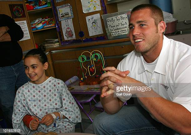 New England Patriots rookie player Dane Fletcher visits patients Emma and Angelina at Children's Hospital Boston on June 9 2010 in Boston...