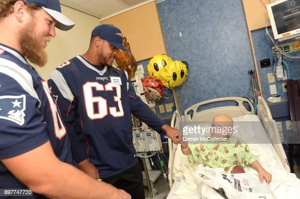 New England Patriots rookies Conor McDermott and Antonio Garcia visit Jose at Boston Children's Hospital June 19 2017 in Boston Massachusetts