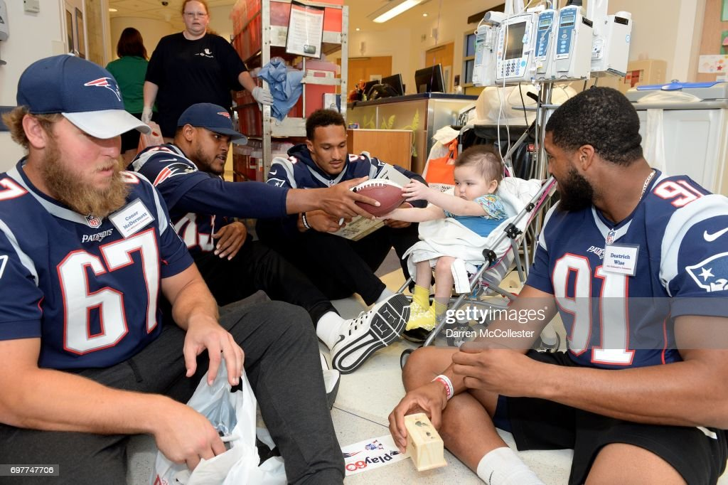 New England Patriots rookies (L to R) Conor McDermott, Antonio Garcia, Derek Rivers, and Deatrich Wise Jr., visit Ketllin at Boston Children's Hospital June 19, 2017 in Boston, Massachusetts.