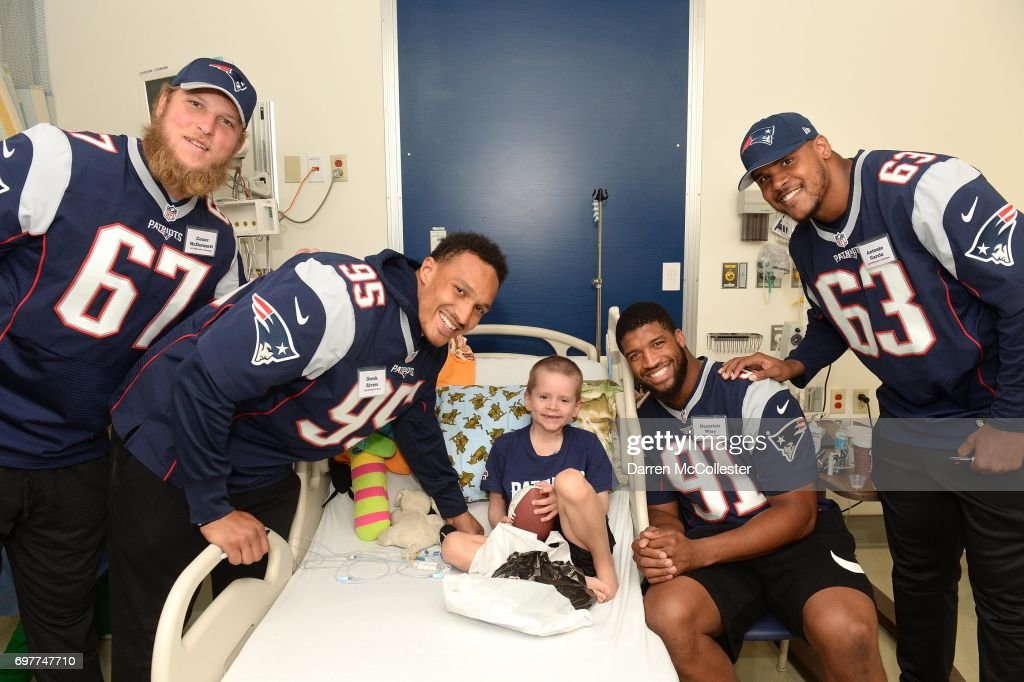 New England Patriots rookies (L to R) Conor McDermott, Derek Rivers, Deatrich Wise Jr., and Antonio Garcia visit Ewan at Boston Children's Hospital June 19, 2017 in Boston, Massachusetts.