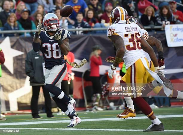 New England Patriots running back Brandon Bolden hauls in a touchdown pass against Washington Redskins defensive back Tanard Jackson and linebacker...