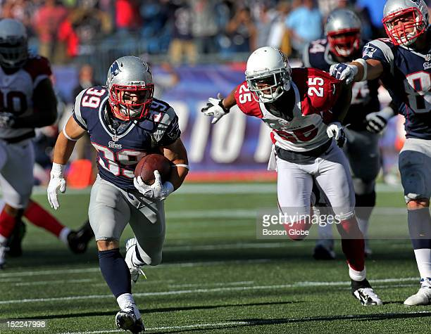 New England Patriots running back Danny Woodhead breaks free for a long touchdown run late in the fourth quarter but the play was brought back due to...