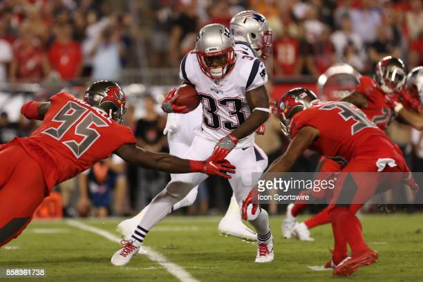 New England Patriots running back Dion Lewis attempts to break a tackle from Tampa Bay Buccaneers defensive back Robert McClain and Tampa Bay...