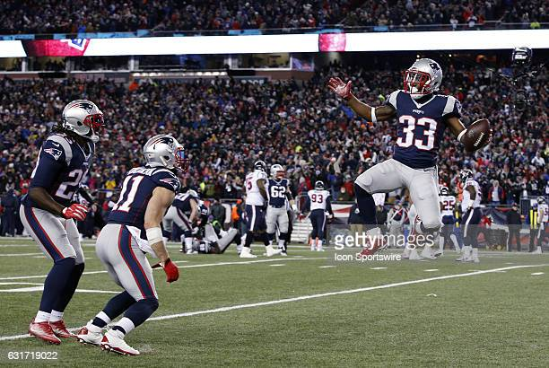 New England Patriots running back Dion Lewis celebrates his rushing touchdown with New England Patriots wide receiver Julian Edelman and New England...