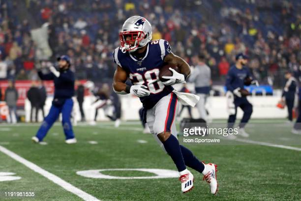 New England Patriots running back James White carries the ball before an AFC Wild Card game between the New England Patriots and the Tennessee Titans...
