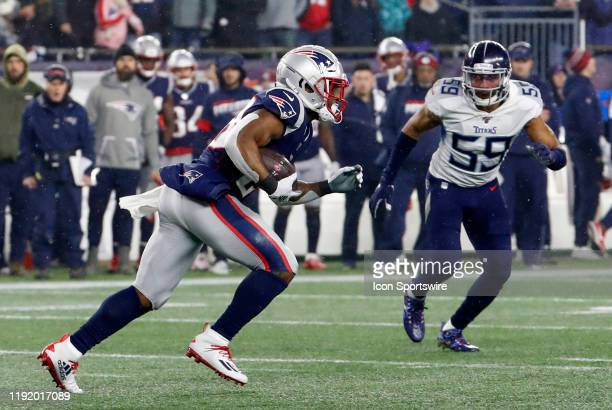 New England Patriots running back James White carries the ball watched by Tennessee Titans inside linebacker Wesley Woodyard during an AFC Wild Card...