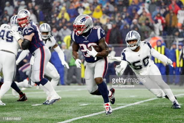 New England Patriots running back James White carries the ball chased. By Dallas Cowboys linebacker Sean Lee during a game between the New England...
