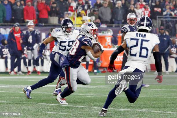 New England Patriots running back James White carries the ball during an AFC Wild Card game between the New England Patriots and the Tennessee Titans...