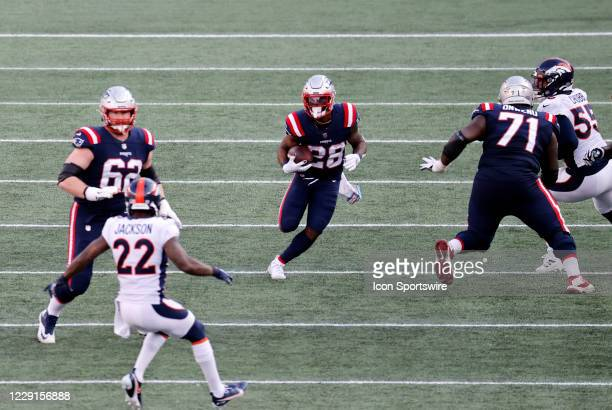 New England Patriots running back James White carries the ball during a game between the New England Patriots and the Denver Broncos on October 18 at...
