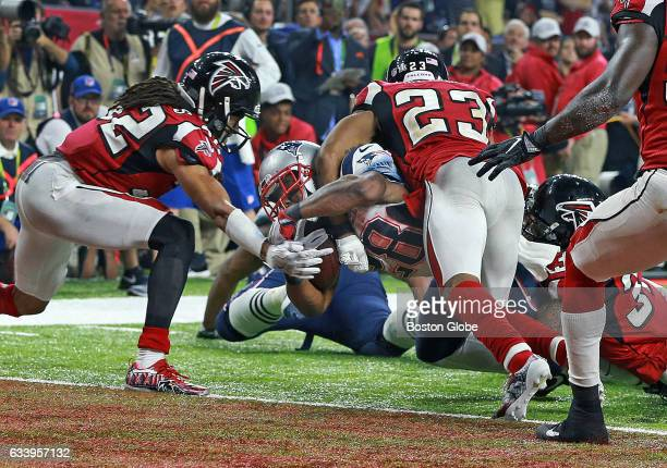 New England Patriots running back James White lunges for the end zone as he scores the game winning touchdown in overtime. The Atlanta Falcons play...