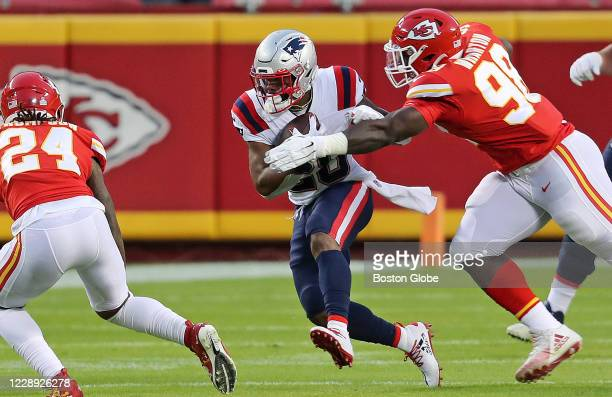 New England Patriots running back James White picks up some yardage after a catch. The Kansas City Chiefs host The New England Patriots for a Monday...