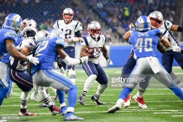 New England Patriots running back James White runs through a big hole in the line during an NFL preseason game between the New England Patriots and...