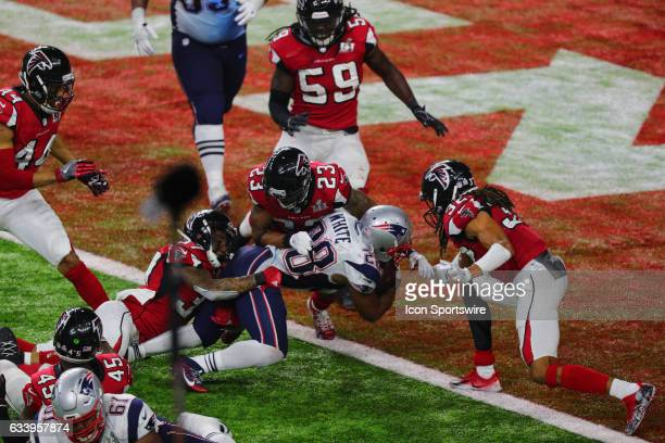 New England Patriots Running Back James White scores the winning touchdown on a 2-yard run in overtime during the New England Patriots 34-28 victory...